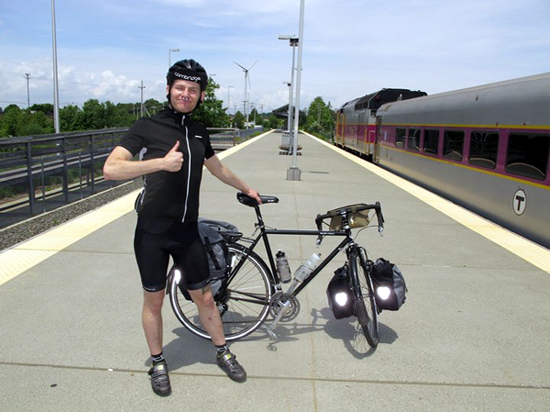 Ben with bike at Amtrak commuter rail stop